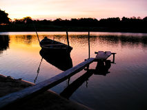 Canoe in sunset Stock Images