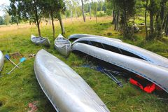 Canoe by a Swedish lake. On the grass Stock Images