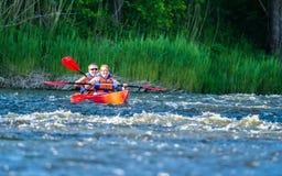 Canoe swift river royalty free stock photos