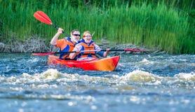 Canoe swift river stock photo