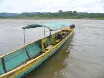 Canoe taxi on river in jungle stock photo