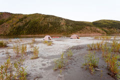 Canoe tent camp at Yukon River in taiga wilderness Stock Photo
