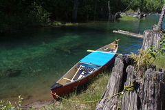 Canoe Tethered to a Lake Shore Royalty Free Stock Images