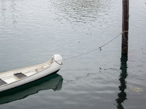 Canoe tethered to mooring post Royalty Free Stock Image