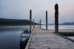 Canoe tied to dock. Royalty Free Stock Photos