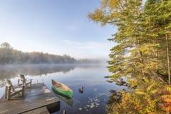 Canoe Tied to a Dock at Dawn. Haliburton, Ontario, Canada stock photos