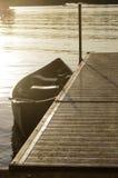 Canoe tied to dock Royalty Free Stock Photography