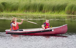 Canoe trip. Woman and boy in a canoe Royalty Free Stock Image