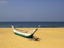 Canoe on a tropical beach Stock Images