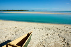 Canoe on tropical beach Stock Photos