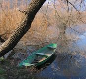 Canoe under the tree Stock Photo