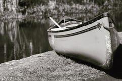 Canoe by the Union Canal in Edinburgh. Black and white canoe on union canal edge in Edinburgh Scotland stock photos