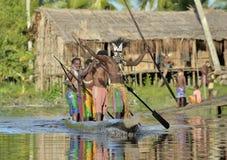 Canoe war ceremony of Asmat. INDONESIA, IRIAN JAYA, ASMAT PROVINCE, JOW VILLAGE - JUNE 23: Canoe war ceremony of Asmat people. Headhunters of a tribe of Asmat Royalty Free Stock Photo