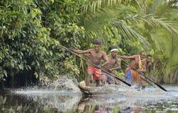Canoe war ceremony of Asmat. INDONESIA, IRIAN JAYA, ASMAT PROVINCE, JOW VILLAGE - JUNE 23: Canoe war ceremony of Asmat people. Headhunters of a tribe of Asmat Stock Photo