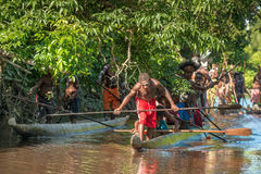 Canoe war ceremony of Asmat Stock Images