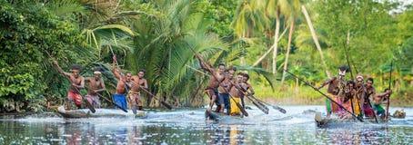 Canoe war ceremony of Asmat. INDONESIA, IRIAN JAYA, ASMAT PROVINCE, JOW VILLAGE - MAY 23: Canoe war ceremony of Asmat people. Headhunters of a tribe of Asmat Stock Photos