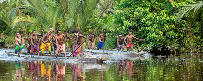 Canoe war ceremony of Asmat. INDONESIA, IRIAN JAYA, ASMAT PROVINCE, JOW VILLAGE - MAY 23: Canoe war ceremony of Asmat people. Headhunters of a tribe of Asmat Stock Photo