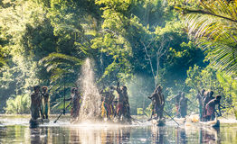 Canoe war ceremony of Asmat. INDONESIA, IRIAN JAYA, ASMAT PROVINCE, JOW VILLAGE - MAY 23: Canoe war ceremony of Asmat people. Headhunters of a tribe of Asmat Stock Photography