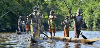 Canoe war ceremony of Asmat. INDONESIA, IRIAN JAYA, ASMAT PROVINCE, JOW VILLAGE - MAY 23: Canoe war ceremony of Asmat people. Headhunters of a tribe of Asmat Royalty Free Stock Image