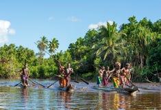 Canoe war ceremony of Asmat. INDONESIA, IRIAN JAYA, ASMAT PROVINCE, JOW VILLAGE - MAY 23: Canoe war ceremony of Asmat people. Headhunters of a tribe of Asmat Royalty Free Stock Images