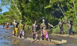 Canoe war ceremony of Asmat. INDONESIA, IRIAN JAYA, ASMAT PROVINCE, JOW VILLAGE - MAY 23: Canoe war ceremony of Asmat people. Headhunters of a tribe of Asmat Royalty Free Stock Photography