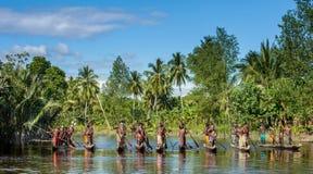 Canoe war ceremony of Asmat. INDONESIA, IRIAN JAYA, ASMAT PROVINCE, JOW VILLAGE - MAY 23: Canoe war ceremony of Asmat people. Headhunters of a tribe of Asmat Royalty Free Stock Photo