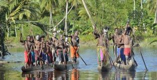 Canoe war ceremony of Asmat. INDONESIA, IRIAN JAYA, ASMAT PROVINCE, JOW VILLAGE - MAY 23: Canoe war ceremony of Asmat people. Headhunters of a tribe of Asmat Royalty Free Stock Photos