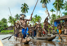 Canoe war ceremony of Asmat people. Headhunters of a tribe of Asmat. Stock Photos