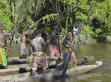 Canoe war ceremony of Asmat people. Headhunters of a tribe of Asmat Stock Photography