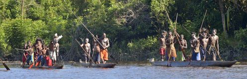 Canoe war ceremony of Asmat people. Headhunters of a tribe of Asmat Stock Image