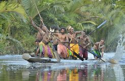 Canoe war ceremony of Asmat people. Headhunters of a tribe of Asmat Royalty Free Stock Photos