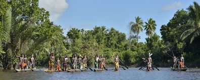 Canoe war ceremony of Asmat people. Headhunters of a tribe of Asmat Royalty Free Stock Images