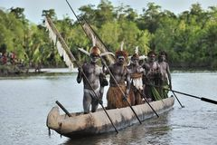 Canoe war ceremony of Asmat people. Headhunters of a tribe of Asmat . New Guinea Island, Indonesia. June 28 2012 Stock Images