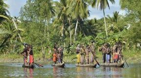 Canoe war ceremony of Asmat people. Headhunters of a tribe of Asmat. INDONESIA, IRIAN JAYA, ASMAT PROVINCE, JOW VILLAGE - MAY 23: Canoe war ceremony of Asmat Stock Photos
