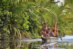 Canoe war ceremony of Asmat people. Headhunters of a tribe of Asmat. INDONESIA, IRIAN JAYA, ASMAT PROVINCE, JOW VILLAGE - MAY 23: Canoe war ceremony of Asmat Stock Photo