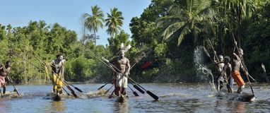 Canoe war ceremony of Asmat people. Stock Photo