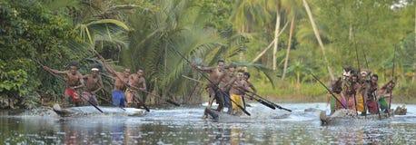 Canoe war ceremony. INDONESIA, IRIAN JAYA, ASMAT PROVINCE, JOW VILLAGE - MAY 23: Canoe war ceremony of Asmat people. Headhunters of a tribe of Asmat . New Guinea Royalty Free Stock Image