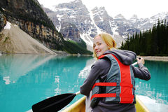 Canoeing. Woman Canoeing on Lake Moraine Royalty Free Stock Photography
