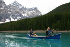 Canoeing. Two canoeists on Moraine Lake Royalty Free Stock Photos
