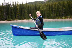 Canoeing. Woman Canoeing on Moraine Lake Royalty Free Stock Image