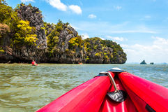 Canoeing along the crag and rocks in Phang nga bay, Thailand Stock Photo