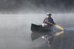 Canoeing on an Autumn Lake Stock Image