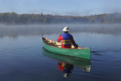 Canoeing on an Autumn Lake Royalty Free Stock Photo