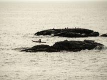 Canoeing on the beach royalty free stock photos