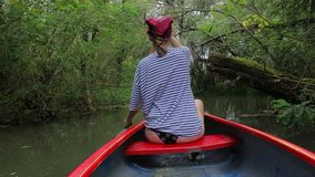 Canoeing on a lake stock video footage