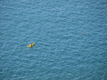 Canoeing in the blue. A canoeist alone in the blue Stock Photo
