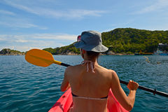 Canoeing in blue water Royalty Free Stock Images