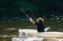 Canoeing boy Stock Images
