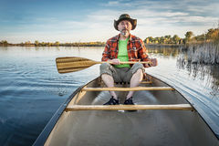 Canoeing on a calm lake in fall Stock Photography
