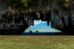 Canoeing through the cave into the lagoon at Phang nga bay, Thai Stock Image